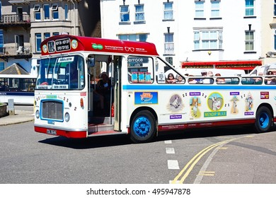 SEATON, UNITED KINGDOM - JULY 18, 2016 - Bristol RE tour bus along a town centre shopping street, Seaton, Devon, England, UK, Western Europe, July 18, 2016.