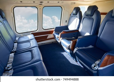 Seats In Empty Helicopter Cabin During Flight