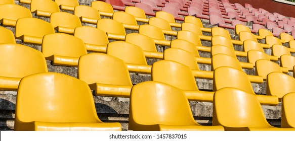 The seats of the old stadium. Old stadium stand close-up.