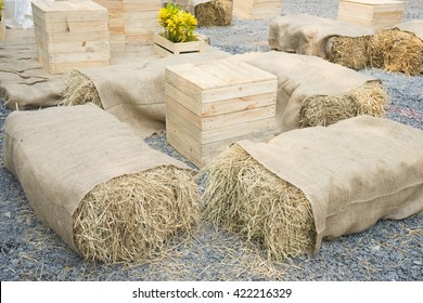 Seats and table made of straw hay and pallet wood