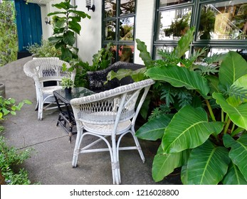 Seats and table at the terrace garden. Lounge chairs on the balcony. Table and chairs in the cafe. Chairs and table at front porch in garden.