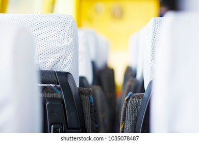 Seats in the tourist bus in row. The concept of traveling by bus