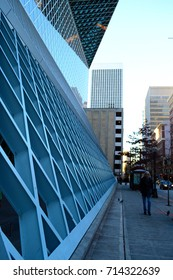 Seattle 2013, street view of one side of the public library with its external blue steel net structure