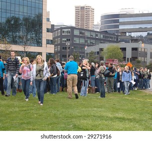 SEATTLE - APRIL 25: Demonstrators gather in a park as part of an event intended to raise awareness of children abducted to serve in a rebel army in Africa April 25, 2009 in Seattle.