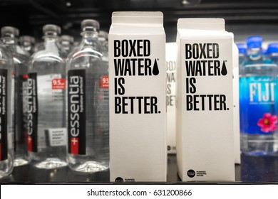 SEATTLE- April 9, 2017: Boxed Water Is Better for sale on a grocery store shelf next to drinking water sold in plastic bottles. The brand using paper cartons is marketed as more eco friendly.