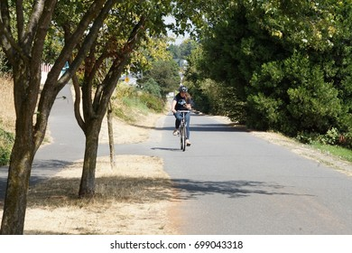 SEATTLE - AUG 18, 2017 -Bicyclist on the Burke Gilman bike trail on a summer day in Seattle, Washington