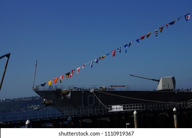 SEATTLE - AUG 4, 2016 - Five inch gun and signal flags of the USS Gridley  (DDG 101) guided missle destroyer, docked in Seattle for Fleet Week