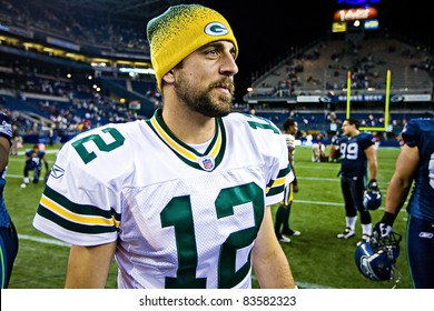 SEATTLE - AUGUST 21:  Superbowl Champion Green Bay Packers Quarterback Aaron Rodgers walks on Qwest Field after winning a football game August 21, 2010 in Seattle, Washington.