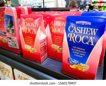 Seattle, California/United States - 10/24/2019: Several packages of Brown & Haley brand Almond Roca and Cashew Roca products on a display case at a convenient store.