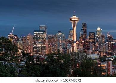 Seattle city skyline at night with illuminated office buildings and Space Needle viewed from public garden near Kerry Park. Seattle, Washington, USA North America 20 September 2017