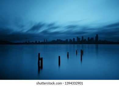 Seattle city skyline view with abandoned pier over sea with urban architecture.
