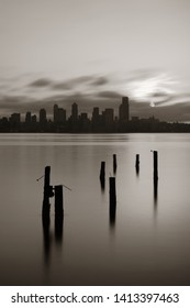 Seattle city skyline view with abandoned pier over sea with urban architecture at sunrise.