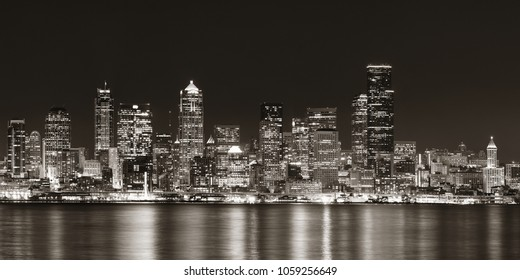 Seattle city skyline view over sea with urban architecture.