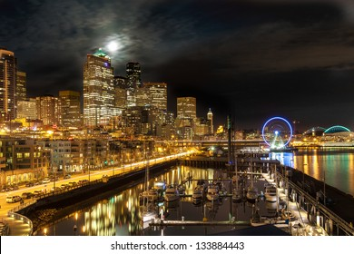 Seattle cityscape at night shot under a full moon