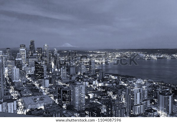 Seattle Cityscape ,View of downtown Seattle and Mount rainier at night in Seattle Washington, USA