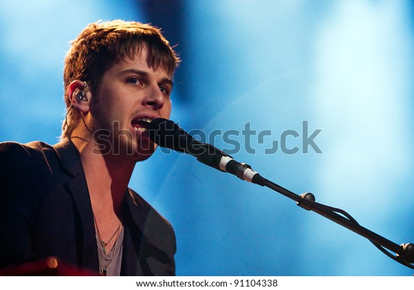 SEATTLE - DECEMBER 7:  Mark Foster of Indie Rock Band Foster the People performs on stage during the Deck the Hall Ball on December 7, 2011 at Key Arena in Seattle.