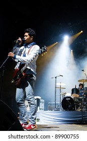 SEATTLE - DECEMBER 8, 2010:  Lead Singer Dougy Mandagi of Australian indie rock band the Temper Trap performs on stage during the Deck the Hall Ball in Seattle on December 8, 2010.