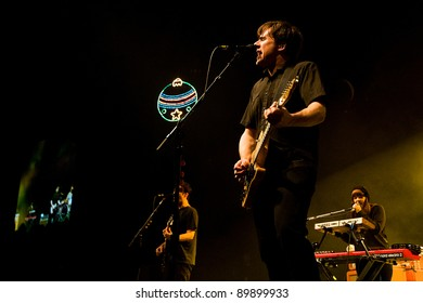 SEATTLE - DECEMBER 8, 2011:  Jim Adkins of American alternative rock band Jimmy Eat World performing on stage during the Deck the Hall Ball in Seattle on December 8, 2011.