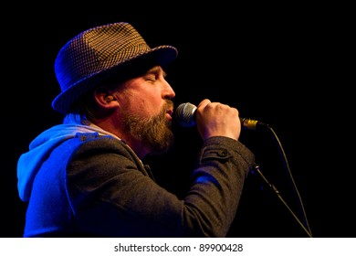 SEATTLE - DECEMBER 8, 2011:  John McCrea of alternative rock band Cake performs on stage during the Deck the Hall Ball in Seattle on December 8, 2011.