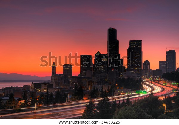 Seattle downtown glowing red in hot summer, freeway traffic in foreground