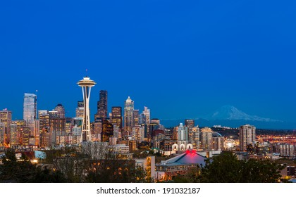 Seattle downtown skyline and Mt. Rainier at night, WA from Kerry park