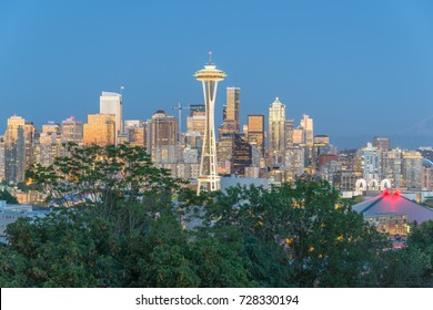 Seattle downtown skylines, urban office buildings with Mt Rainier at blue hour as seen from Kerry Park.