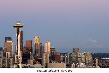 Seattle highrises with Space needle and mount Rainier in the evening