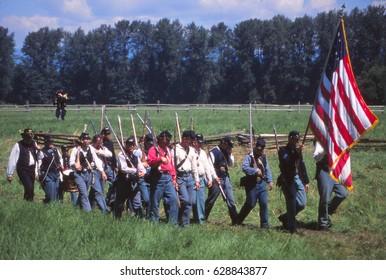 SEATTLE - JUL 10, 1996 - Infantry maneuvers during a Civil War battle reenactment near Seattle