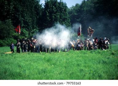 SEATTLE - JUL 10 - Union artillery fires their gun in a Civil War battle reenactment on July 10, 1996 near Seattle.