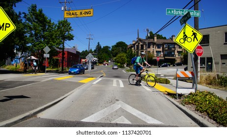SEATTLE - JUL 14, 2018 - Bicyclists at a traffic crossing on the Burke Gilman Trail in Seattle