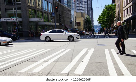 SEATTLE - JUL 15, 2018 - Pedestrian crossing the street in downtown Seattle, Washington