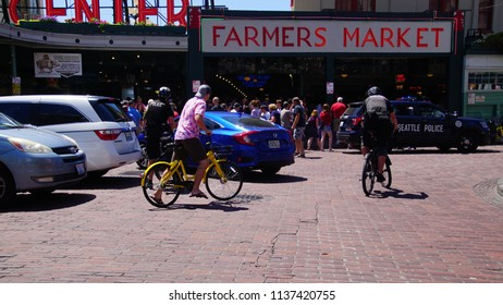 SEATTLE - JUL 15, 2018 - Police on bicycles ride through the Pike Place Market in downtown Seattle, Washington