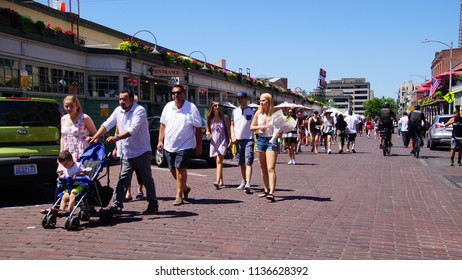 SEATTLE - JUL 15, 2018 - Tourists and locals mingle at the  Pike Place Market in Seattle, Washington