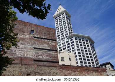 SEATTLE - JUL 23, 2015 - The Smith Tower rises above old brick building near Pioneer SquareSeattle, Washington