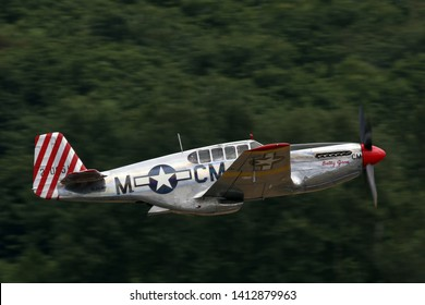 SEATTLE - JULY 03, 2016: A very rare TP-51C Mustang owned by the Collings Foundation was seeing flying in the skies over Seattle, WA. This was only 5 built during WWII.
