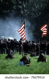SEATTLE - JULY 10 : Union infantry line fires on advancing  Confederate soldiers, during a Civil War battle reenactment on July 10, 1996 near Seattle.