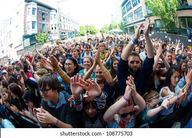 SEATTLE - JULY 22:  Thousands of fans cheer for the Lumineers during the Capitol Hill Block Party in Seattle on July 22, 2012