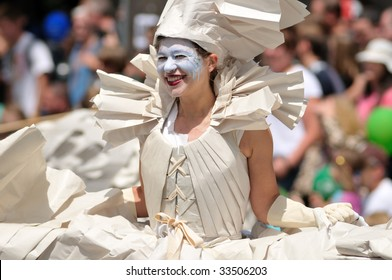 SEATTLE - JUNE 20: woman dressed in paper during the 38th Annual Fremont Solstice Parade on June 20, 2009 in Seattle, WA.  This annual parade encourages artists throughout the community.