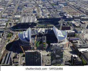SEATTLE - JUNE 24: Aerial view of CenturyLink, train tracks, buildings, roads and Safeco Field in Seattle in June 24, 2016. Home of the Seattle Seahawks (NFL), Mariners (MLB) and Sounders (MLS).