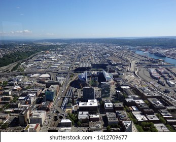 SEATTLE - JUNE 25: Aerial view of CenturyLink, train tracks, buildings, harbor, roads and Safeco Field in Seattle in June 25, 2016. Home of the Seattle Seahawks (NFL), Mariners (MLB) and Sounders.