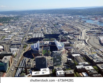 SEATTLE - JUNE 25: Aerial view of CenturyLink, train tracks, buildings, roads and Safeco Field in Seattle in June 25, 2016. Home of the Seattle Seahawks (NFL), Mariners (MLB) and Sounders (MLS).