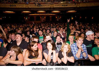SEATTLE - JUNE 27:  A packed house filled with fans of the Dropkick Murphys cheer inside the Paramount Theater in Seattle on June 27, 2011.