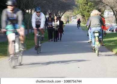 SEATTLE - MAR 31, 2018 - Blurred motion of bicyclist on a spring day on the Burke Gilman bike trail in Seattle, Washington