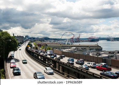 SEATTLE - MAY 10: Traffic on Alaskan Way moves past The Seattle Great Wheel Ferris wheel at Pier 57 near Seattle's downtown waterfront on May 10, 2014.