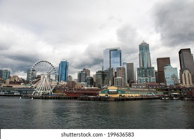 SEATTLE - MAY 10: A view of the Seattle Great Wheel, Pier 57, and Seattle skyline seen from Elliott Bay on May 10, 2014.