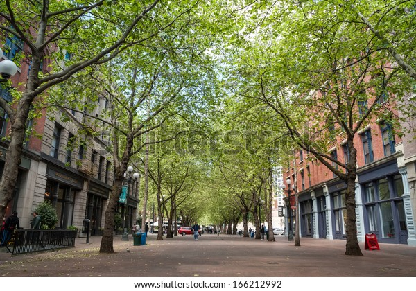SEATTLE - MAY 19: Occidental Avenue on May 19 in Seattle. Occidental Park is in the heart of the historic Pioneer Square district, built in 1971, during the general renovation of the area.