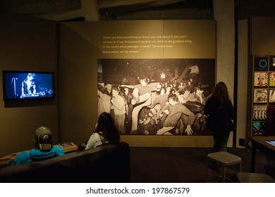 "SEATTLE - MAY 8: Visitors of the EMP Museum experience the exhibit ""Nirvana: Taking Punk to the Masses"" on May 8, 2014 in Seattle."