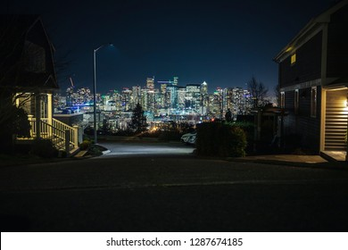 Seattle Neighborhood Residential Street View of Bright City Skyline at Night
