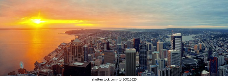Seattle rooftop panorama view with urban architecture at sunset.