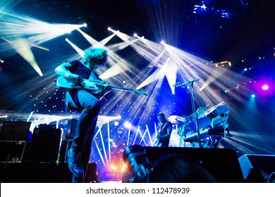 SEATTLE - SEPTEMBER 3, 2012:  French electronic pop band M83 performs on the main stage at Key Arena during the Bumbershoot music festival in Seattle on September 3, 2012.